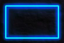 Blue Neon Light On A Brick Wal...