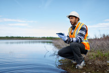 Marine Biologist Analysing Water Test Results On A Tablet In Can
