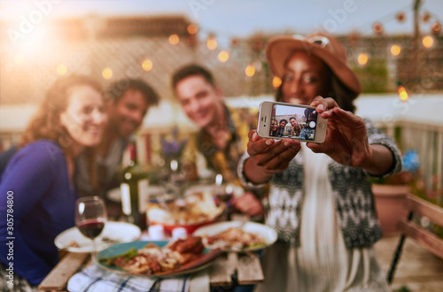 Cuadros en Lienzo Group of diverse friends taking selfies pictures having dinner a