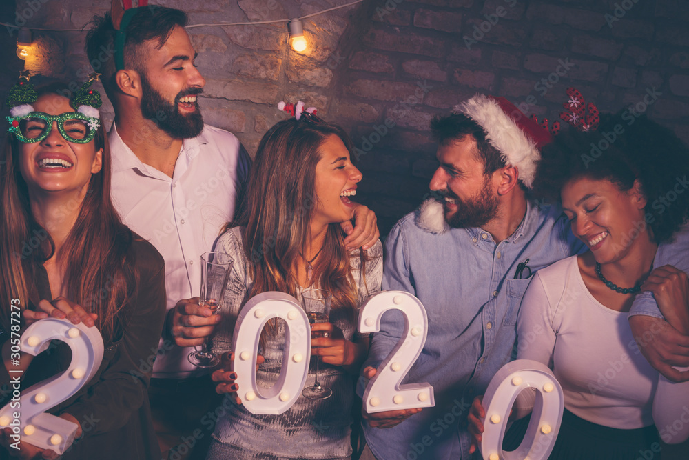 Fototapety, obrazy: Group of people holding illuminative numbers 2020 at New Years party