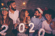 canvas print picture - Group of people holding illuminative numbers 2020 at New Years party
