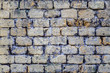 old shabby beige castle wall made of concrete gray bricks. rough surface texture