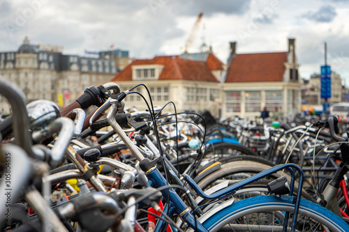 Photo  Pile of bikes parked near the Central Station in Amsterdam