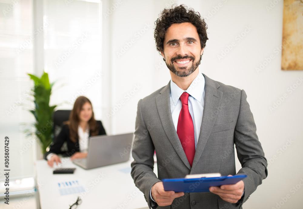 Fototapeta Smiling businessman in his office