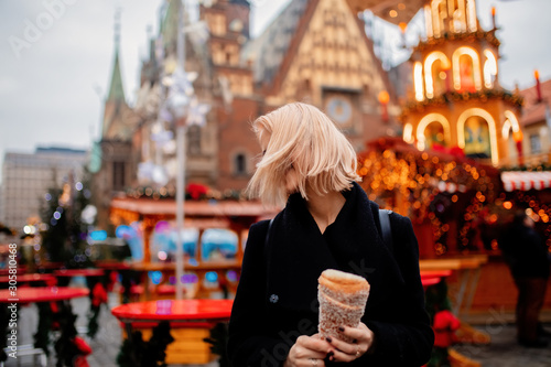 beautiful blonde with spit cake at the Christmas market in Wroclaw, Poland Canvas-taulu