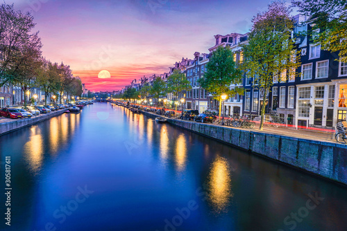 Long exposure shot of canal side dutch architecture during sunset