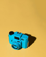 Blue Toy Camera On Yellow Background