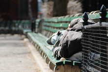 A Man Sleeping On A Bench In New York City