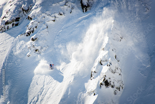 Photographie Snowboarder, Skier caught in the snow avalanche