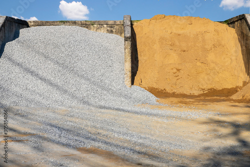Heap of stone and sand at a construction material warehouse for sale Fototapet