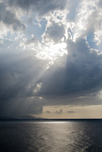Sun Peeking Through Dark Wet S...