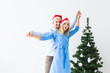 Holidays and celebration concept - Young couple celebrating Christmas at home