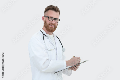 Valokuvatapetti friendly doctor with clipboard. isolated on white