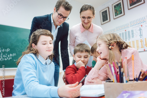 Fototapety, obrazy: Group work session in school with teachers and pupils