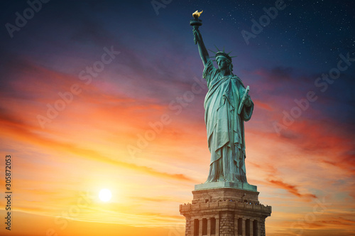 New York City, The Statue of Liberty in a colorful sunset. Wallpaper Mural