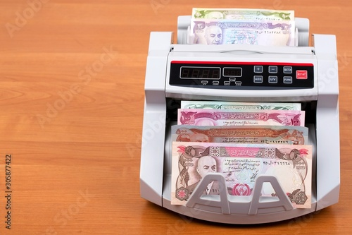 Fotografie, Obraz  Old money from Afghanistan - Afghani in a counting machine