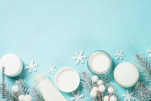 Poster de jardin Individuel Winter cream for skin on blue top view.
