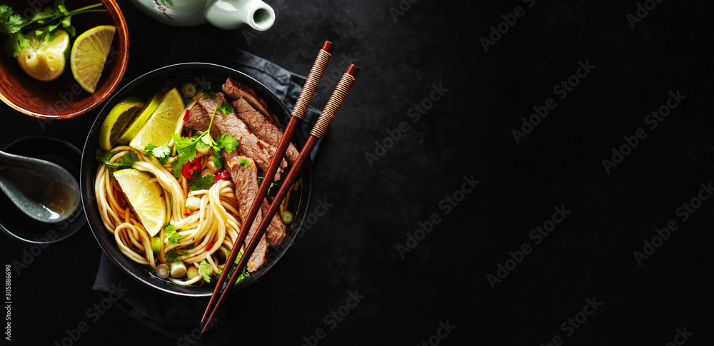 Fototapeta Tasty asian classic soup with noodles and meat