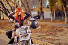 Close Up Red-haired Female Bik...