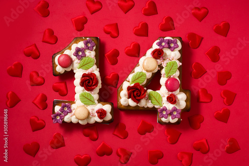 Photo  Valentine's Day cake with 14 number shape and hearts on red background