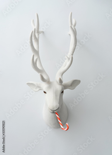 Cadres-photo bureau Pays d Asie Christmas reindeer decoration with christmas candy. Creative minimal funny holiday concept.