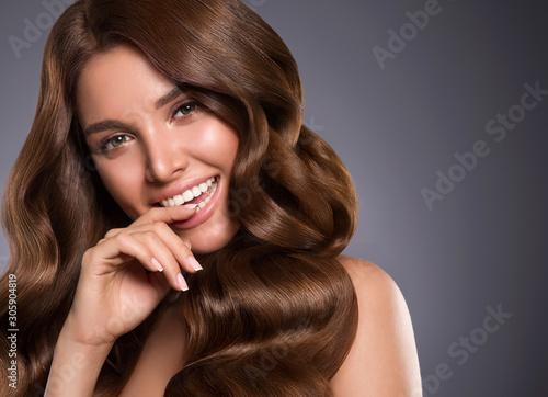 Beautiful hair woman long curly hairstyle  healthy teeth smilenatural makeup