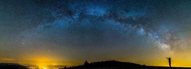 Milky way and girl in Montsec, Lleida, Pyrenees, Catalonia, Spain