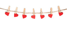 Clothes Pegs And Red Wooden Hearts On Rope Isolated On White Background
