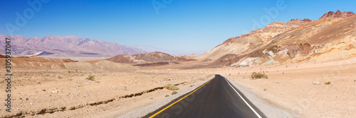 Road through the desert of Death Valley National Park - 305937047