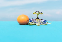 Passion Fruit And Flower On A Bright Blue Background On The Beach On The Island Of Corfu, Greece. Positive. Happy Mood.