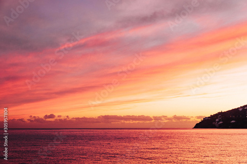 Poster Corail Gorgeous wallpaper sundown background at Amalfy coast, Italy with magnificent luminous colors