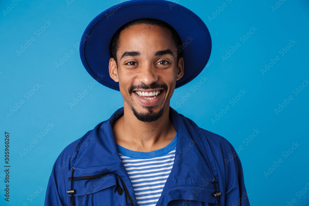 Fototapeta Photo of funny african american man smiling and looking at camera