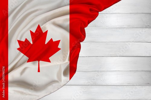horizontal colored national flag of modern state of Canada, beautiful silk, white wood background, concept of tourism, economy, politics, emigration, independence day, copy space, template