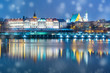 canvas print picture - Old Town with reflection in the Vistula River during snowy evening blue hour, Warsaw, Poland.