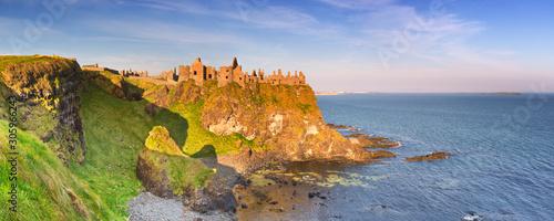 Fototapeta Dunluce Castle in Northern Ireland on a sunny morning