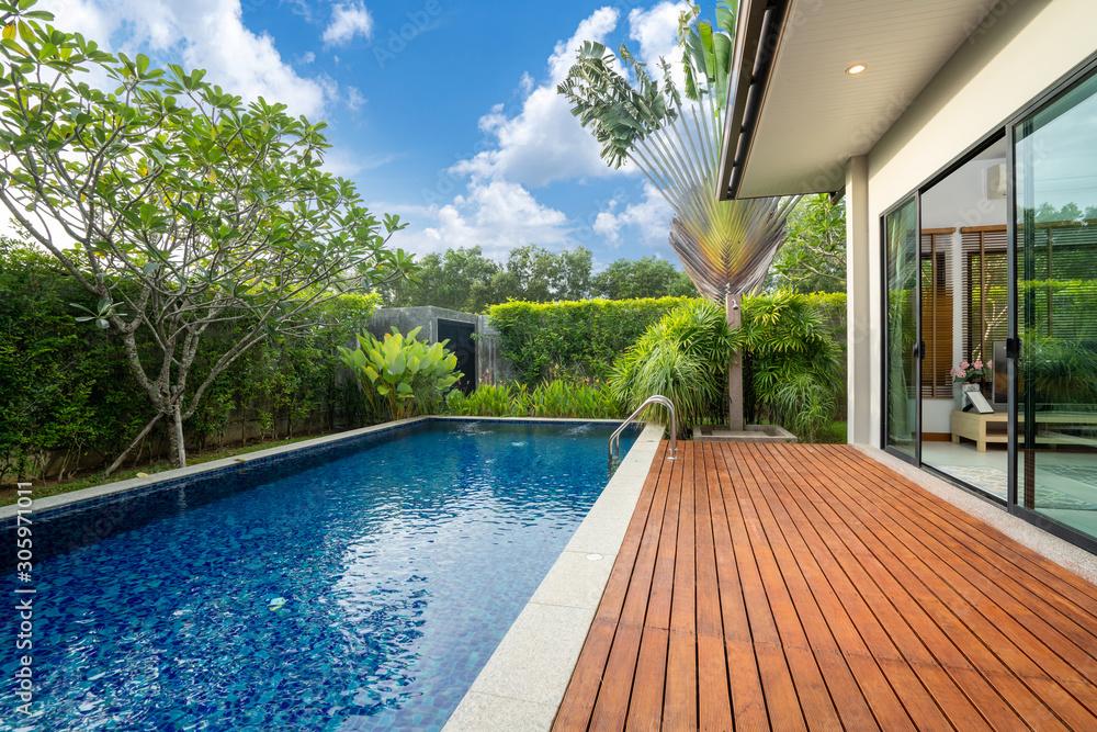 Fototapeta swimming pool and decking in garden of luxury home - obraz na płótnie