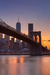 Brooklyn Bridge and New York City skyline at sunset