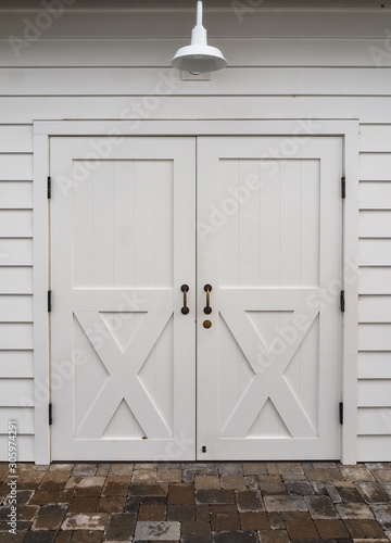 Isolated white barn doors with metal hardware Wallpaper Mural