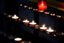 Prayer Candles Lit Inside A Ch...