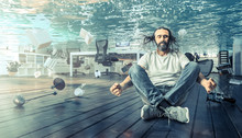Man Sitting Underwater Who Relaxes In A Yoga Position.