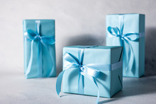 Present Box With Blue Bow Isolated On Gray Background