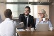 Smiling diverse employers handshake job applicant at interview