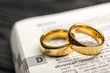 canvas print picture - Divorce and separation concept. Two golden wedding rings. Dictionary definition