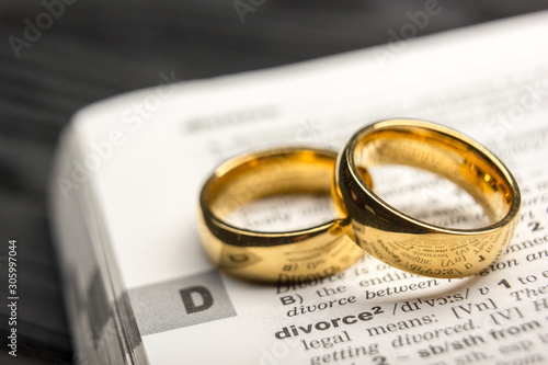 Fototapeta Divorce and separation concept. Two golden wedding rings. Dictionary definition obraz
