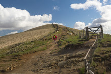 A Runner Running Along The Mam Tor Trail In The Peak District, Derbyshire