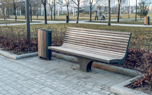 Modern Wooden Bench And Urn In The Park. Design Of Urban Public Space. The Landscape Park.