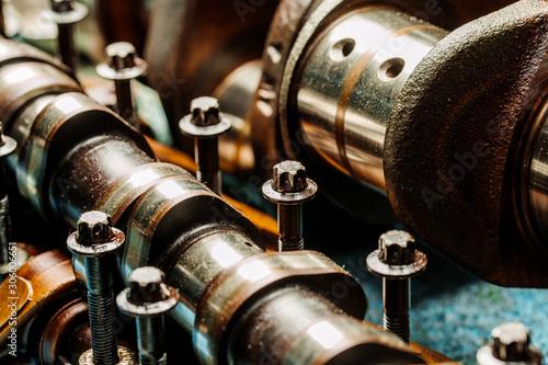 Сar engine after remove the cover part in a workshop. Slika na platnu