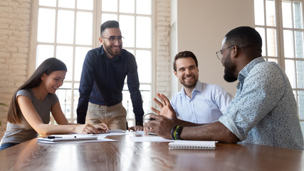 Joyful multiracial business people partners having fun during break time.