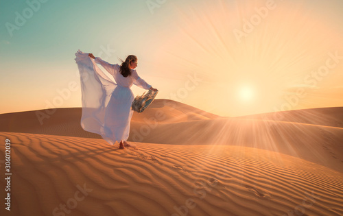 UAE. Woman in desert - 306012039