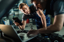 Young Auto Mechanic And His Co...